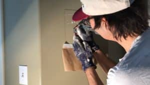 Brad the painter showing how to touch up paint