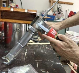 Painter showing How to use a caulk gun