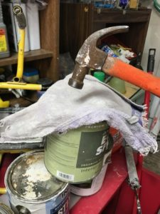 Paint storage - place a rag before hammering