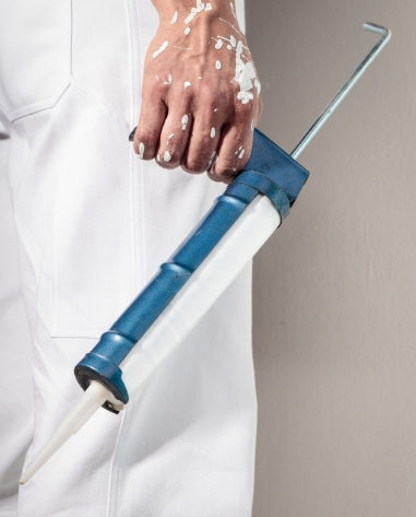 Painter holding a caulking gun