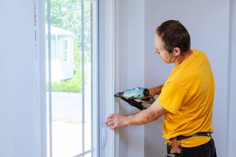 Man using a high quality finish nailer on trim