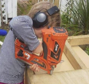 child uses a paslode framing nailer