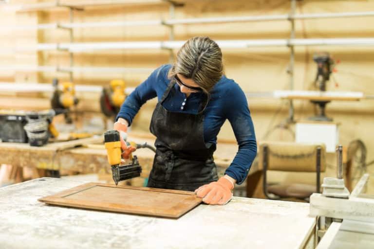 Woman using a quality brad nailer