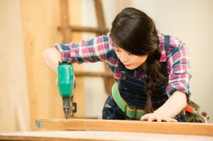 Woman working with a Quality Pin Nailer