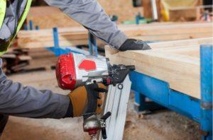 Working man using a quality framing nailer