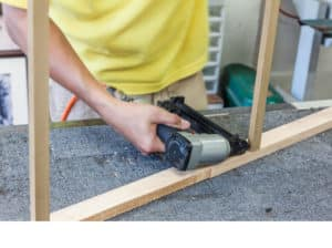 worker with a brad nail gun