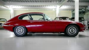 Red Jaguar on Garage Floor Painted White