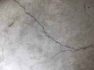 Concrete floor with cracks in paint