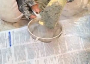Making fine sand for textured concrete floor paint