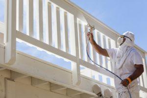 man spraying deck with pro paint sprayer