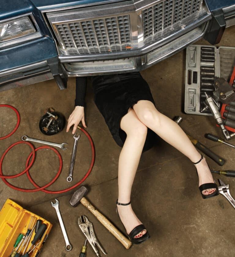 woman working on garage floor