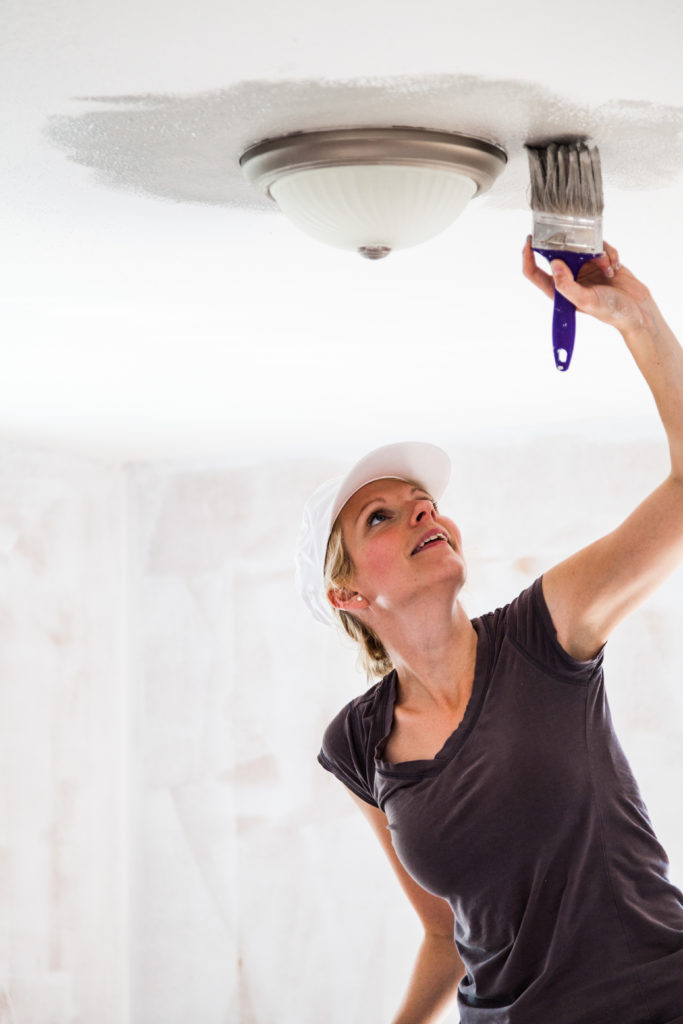 Woman Painting with Benjamin Moore Ceiling Paint